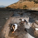 Western Turkey, Selçuk, Ancient city of Ephesus. Archaeologists BERKER KALFA and UTKU INÇE cleaning a noble bizantin mosaic ( IV cent AD) found in the proximity of the temple of Domitianus. This was the area where lived the upper class.